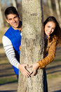 Happy young couple in love having fun at the park portrait of Royalty Free Stock Photography