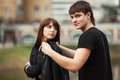 Happy young couple in love outdoor men and women leather jackets Stock Photography