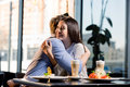 Happy young couple in love at romantic date in restaurant Royalty Free Stock Photo