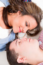 Happy young couple in love upside down facing each other Royalty Free Stock Photos