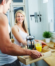 Happy young couple making breakfast Royalty Free Stock Photos