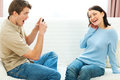 Happy young couple making fun photos Royalty Free Stock Photography