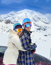 Happy young couple in mountains snowboarders of alps Royalty Free Stock Images