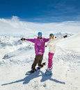Happy young couple in mountains snowboarders of alps Stock Images