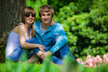 Happy young couple in park Royalty Free Stock Images