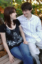Happy young couple on park bench Royalty Free Stock Photography