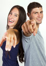 Happy young couple pointing at the camera portrait of Stock Images