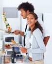 Happy young couple preparing food together at home Royalty Free Stock Image