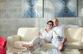 Happy young couple relax at home modern living room indoor Stock Image
