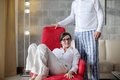 Happy young couple relax at home modern living room indoor Royalty Free Stock Image
