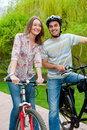 Happy young couple riding bicycles Royalty Free Stock Photography
