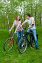 Happy young couple riding bicycles Royalty Free Stock Photos