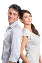 Happy young couple shoulder to shoulder isolated over white background Royalty Free Stock Photo