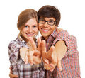 Happy young couple showing v sign Stock Photo