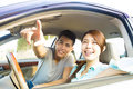 Happy Young Couple Sitting In the Car Royalty Free Stock Photo