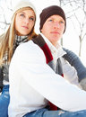 Happy young couple sitting during winter Stock Photo