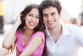 Happy young couple smiling outdoors Royalty Free Stock Photos