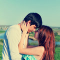 Happy young couple in the spring park family outdoors image Royalty Free Stock Photo