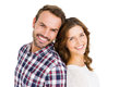 Happy young couple standing back to back portrait of on white ground Stock Photo