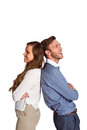 Happy young couple standing back to back side view of over white background Royalty Free Stock Photos