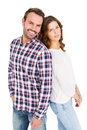 Happy young couple standing back to back on white ground Royalty Free Stock Photos