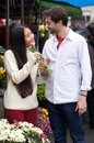 Happy young couple standing by flower shop Royalty Free Stock Photo