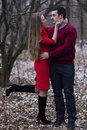 Happy young couple standing and hugging in park winter woman bens knee Stock Images