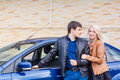Happy young couple standing near the car Royalty Free Stock Photo