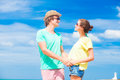 Happy young couple in sunglasses smiling pointing Royalty Free Stock Images