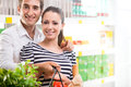 Happy young couple at supermarket Royalty Free Stock Photo