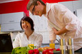 Happy young couple in their kitchen Stock Image