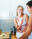 Happy young couple together in their kitchen Royalty Free Stock Photos