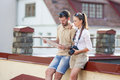 Happy Young Couple Traveling Together. Exploring City Map in City Royalty Free Stock Photo