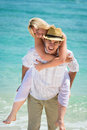 Happy young couple on tropical beach Stock Photos