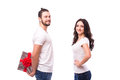 Happy young couple with Valentine's Day present isolated on a white background.