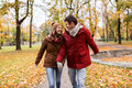 Happy young couple walking in autumn park Royalty Free Stock Photo
