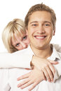 Happy young couple on a white Royalty Free Stock Photo