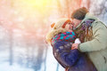 Happy Young Couple in Winter Park laughing and having fun. Family Outdoors. Royalty Free Stock Photo