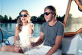 Happy young couple on a yacht drinking champagne Royalty Free Stock Photos