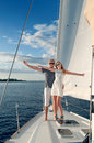 Happy young couple on a yacht relaxing Royalty Free Stock Images