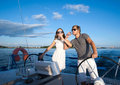 Happy young couple on a yacht relaxing Stock Images