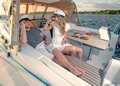 Happy young couple on a yacht relaxing Stock Photo