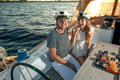 Happy young couple on a yacht relaxing Royalty Free Stock Photography