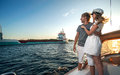Happy young couple on a yacht relaxing Stock Photography