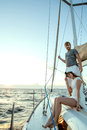 Happy young couple on a yacht relaxing Royalty Free Stock Photos