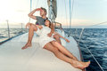 Happy young couple on a yacht relaxing Stock Photos