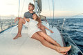 Happy young couple on a yacht relaxing Royalty Free Stock Photo