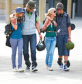 Happy young couples walking together on street Stock Photography