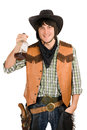 Happy young cowboy with a bottle Royalty Free Stock Images