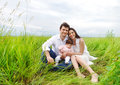 Happy young family with baby girl Stock Images